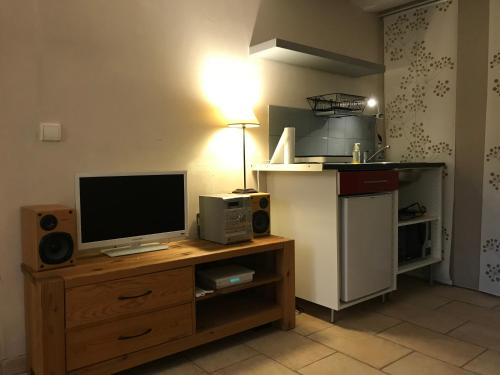 A television and/or entertainment center at Quiet Appart