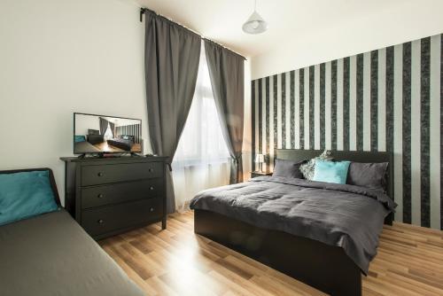 Un ou plusieurs lits dans un hébergement de l'établissement Neklanova Apartments