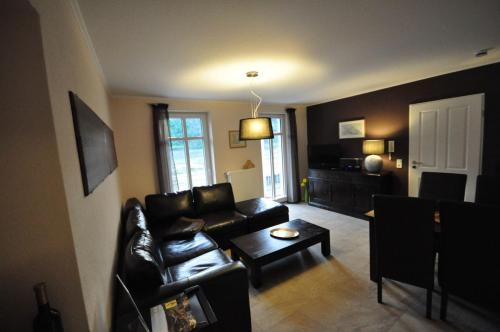 A seating area at Apartments / Ferienwohnungen Moseluferstrasse
