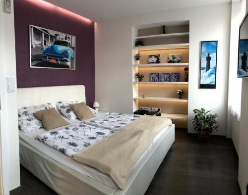 Tempat tidur dalam kamar di Agnes - Apartments
