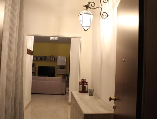 A television and/or entertainment center at Carbonara Apartment