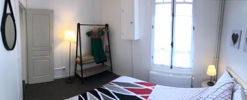 Un ou plusieurs lits dans un hébergement de l'établissement Bilocale in Avenue du Progres