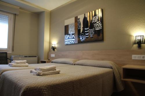 Cama o camas de una habitación en Alojamientos Acella