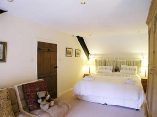 A bed or beds in a room at Highfield Barn