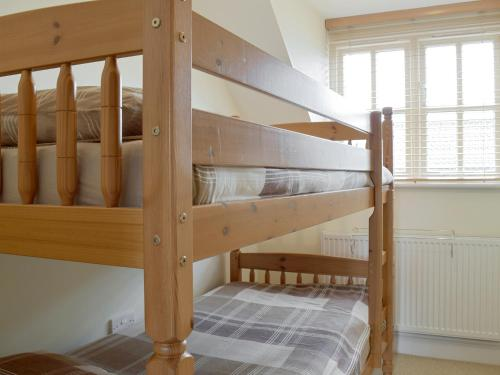 A bunk bed or bunk beds in a room at Dormers