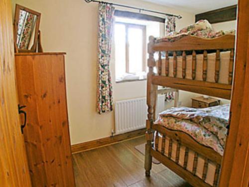 A bunk bed or bunk beds in a room at Hindriggs Cottage