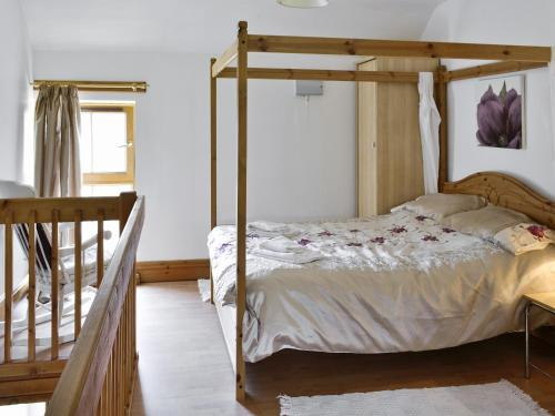 A bunk bed or bunk beds in a room at The Calf Shed