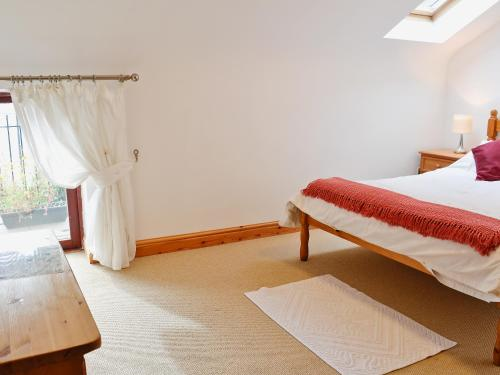 A bed or beds in a room at Keld House Farm