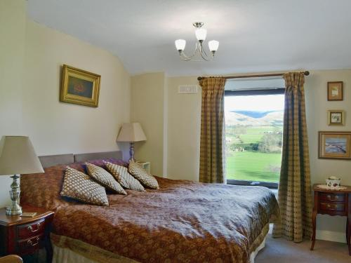 A bed or beds in a room at Pennine View