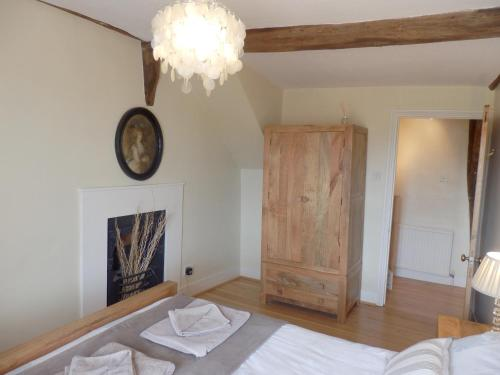 A bed or beds in a room at Guild Cottage