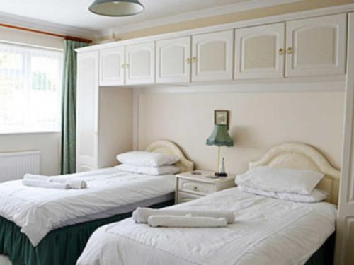 A bed or beds in a room at Brierley