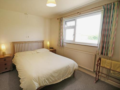 A bed or beds in a room at Field Way