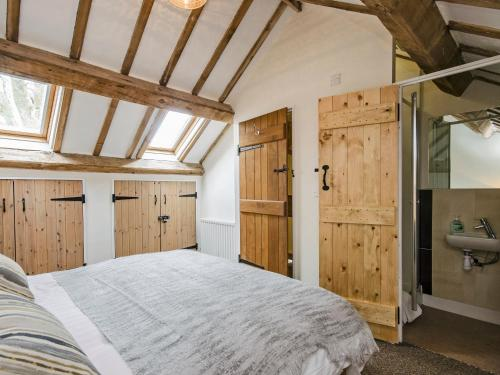A bed or beds in a room at Valley View Barn