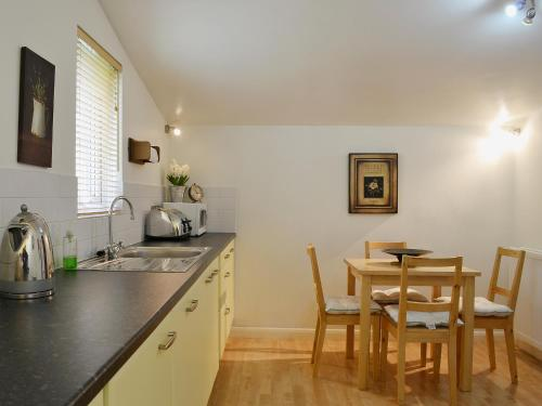 A kitchen or kitchenette at High Moor Cottage