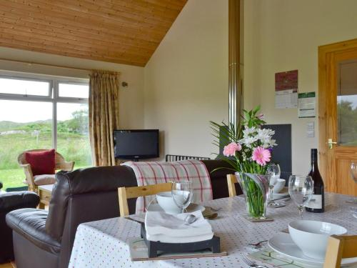 A restaurant or other place to eat at Riverview Cottage