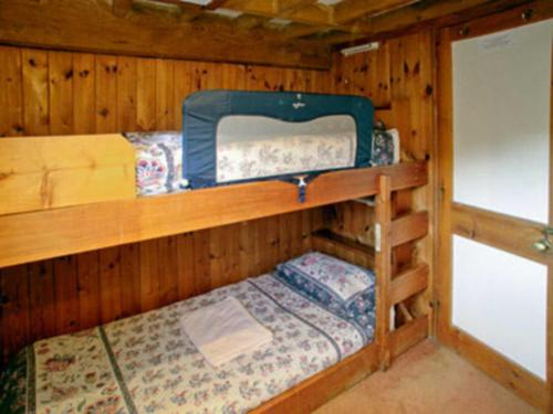 A bunk bed or bunk beds in a room at Erbistock Mill