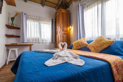 A bed or beds in a room at Posada Lune de Miel