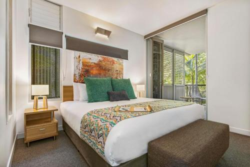 A bed or beds in a room at Peppers Noosa Resort and Villas
