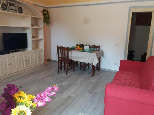 Area soggiorno di Casa rosa Andrea barbera