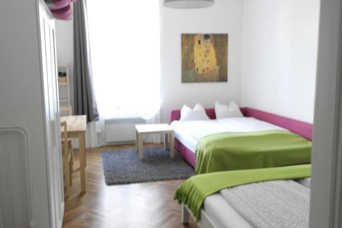 A bed or beds in a room at City-Apartments Langegger