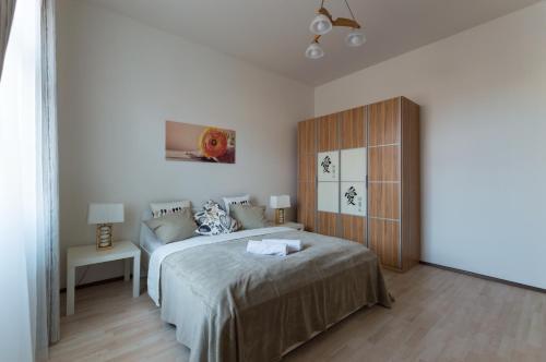 Кровать или кровати в номере Kubelikova APARTMEET