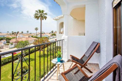A balcony or terrace at Sea View Apartment at urbanisation Las Farolas