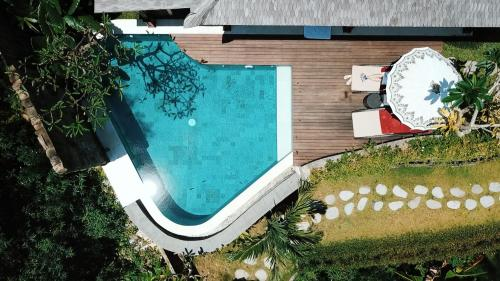 The swimming pool at or near Nau Villa Ubud