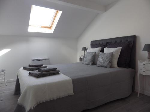 Un ou plusieurs lits dans un hébergement de l'établissement Les Tournelles