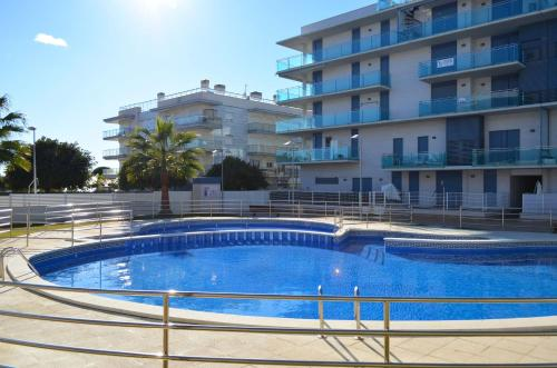 The swimming pool at or near Esquirol Beach Glorieta