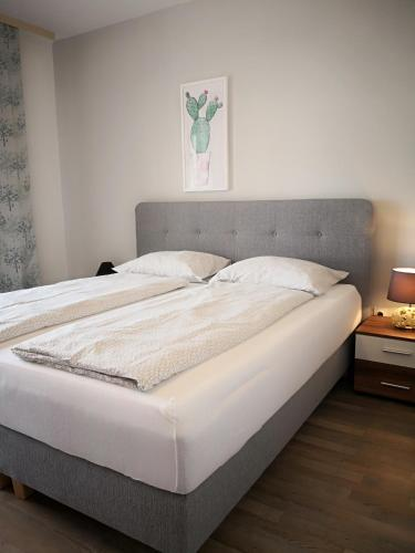 A bed or beds in a room at Apartments Casa Ivano