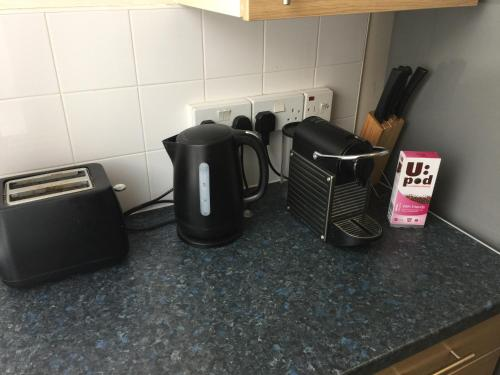 Coffee and tea-making facilities at Nice Apartment in Royal Greenwich