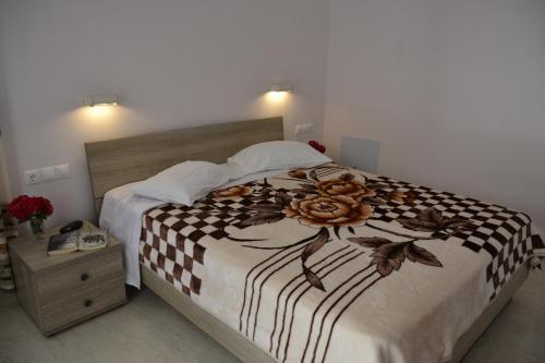 Ένα ή περισσότερα κρεβάτια σε δωμάτιο στο Geroulis Stefanos Studios