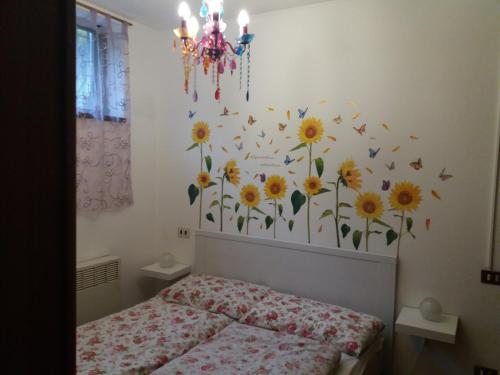 A bed or beds in a room at Villetta Claudetta