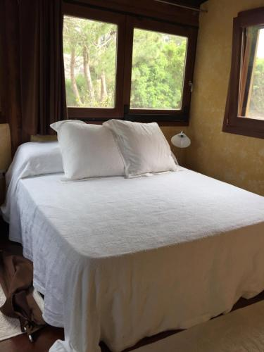 A bed or beds in a room at Villa Con Piscina a Carloforte