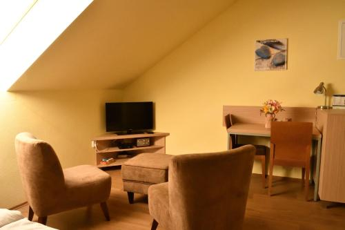 A seating area at Vendelin Apartmany