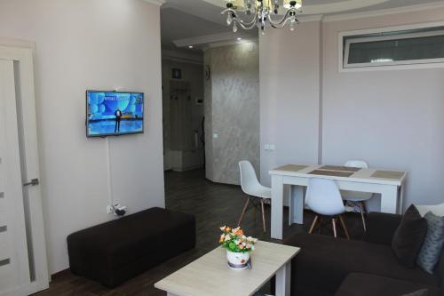 Телевизор и/или развлекательный центр в BHP Apartments