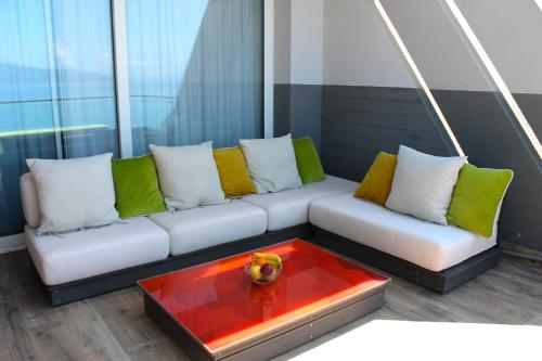 A seating area at Aless Luxury Apartment