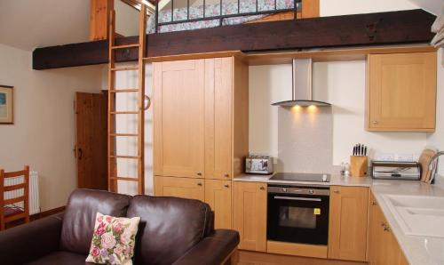 A kitchen or kitchenette at Budleigh Farm Cottages