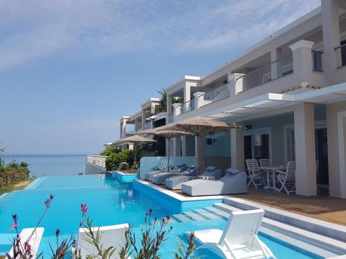 The swimming pool at or close to Paralia Luxury Suites