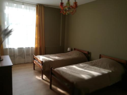 Letto o letti in una camera di Apartment Avrora