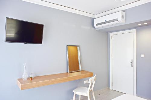 A television and/or entertainment center at Alkyoni City Apartment