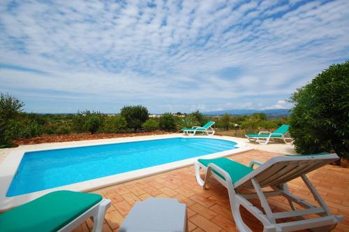 The swimming pool at or near Algarve Casa da Eira