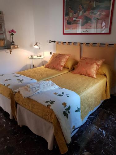 A bed or beds in a room at B&B Gloria