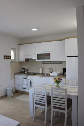 A kitchen or kitchenette at Marija Holiday Home