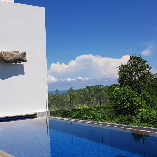 Sundlaugin á Villa Omah Bali eða í nágrenninu