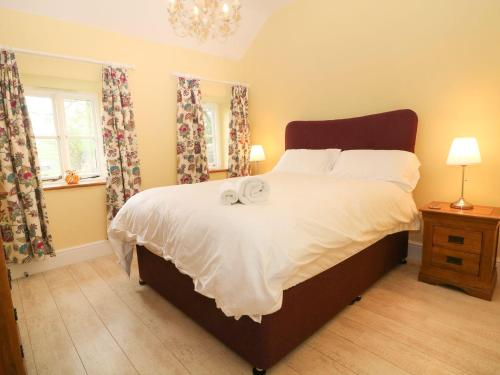 A bed or beds in a room at 3 Bryn Ysgol, Betws-y-Coed