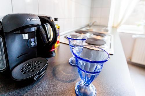 A kitchen or kitchenette at Apartments Mönchengladbach