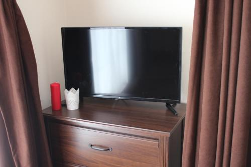 A television and/or entertainment center at Emma Apartments