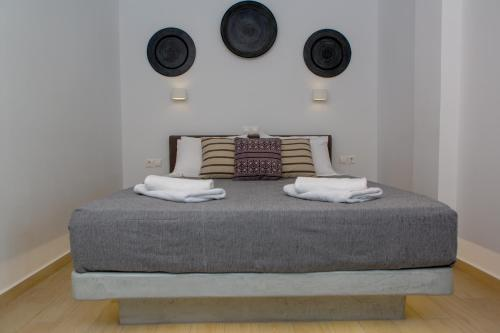A bed or beds in a room at La isla