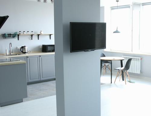 Телевизор и/или развлекательный центр в Apartment Zhemchuzhina Viktorii